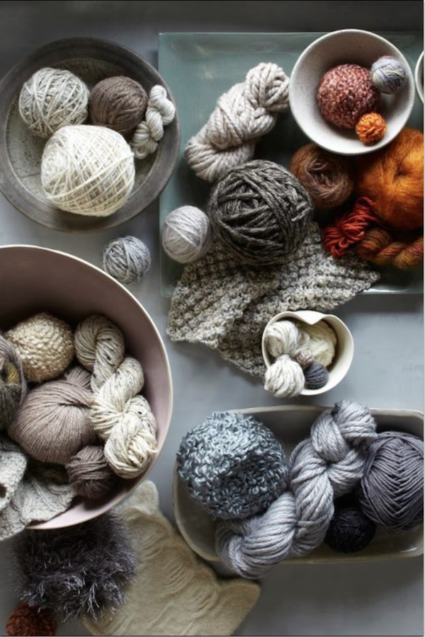 Yarn palette completely emphasizing my color scheme idea: a selection of neutrals that are accented with strong bright reds and coppers. Image sourced from Textile Nerd.