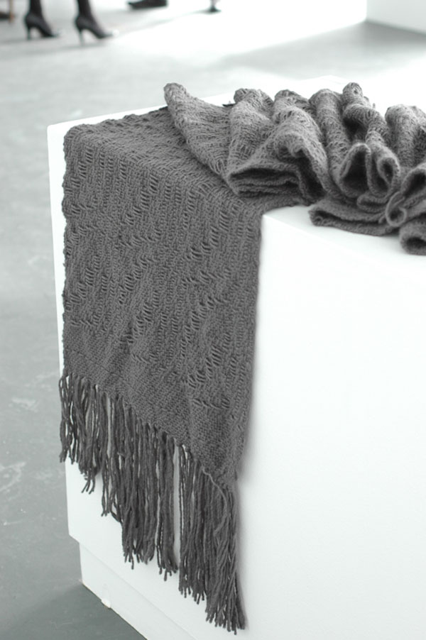 This piece was woven with an overshot pattern using the same yarn in both the warp and weft.