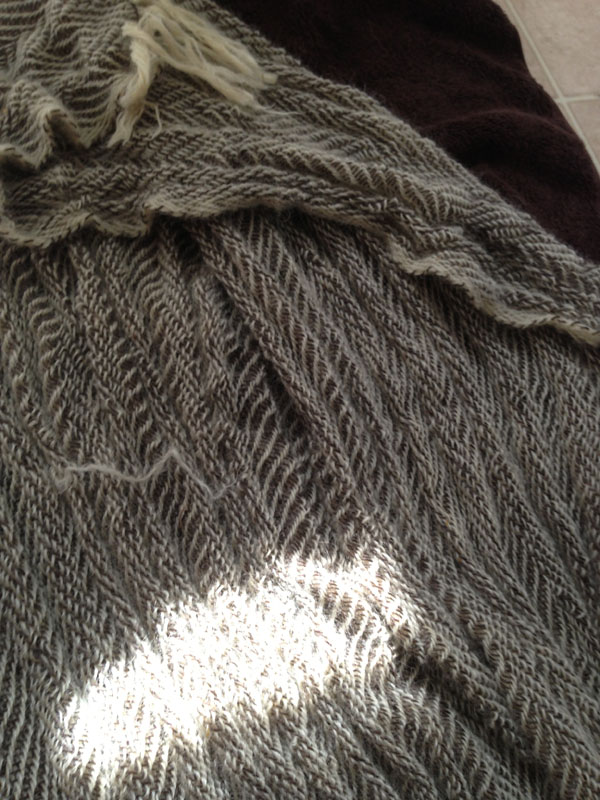 The blanket forming a wonderful textural landscape.